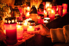 Candles on a cemetery. Candles Burning At a Cemetery During All Saints Day. Shallow depth of field Royalty Free Stock Photos