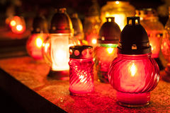Candles on a cemetery. Candles Burning At a Cemetery During All Saints Day. Shallow depth of field Stock Photo