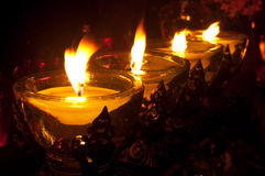 Candles in the cemetery. Yellow lighted candles at the cemetery Stock Photos