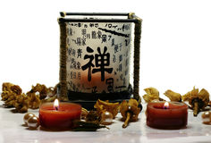 Candles and Chinese holder. A background of candles and a holder with Chinese characters Royalty Free Stock Image