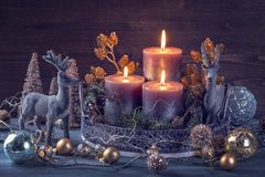 Candles and christmas decoration. On a wooden background stock image