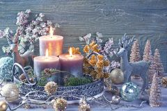 Candles and christmas decoration. On a wooden background royalty free stock images