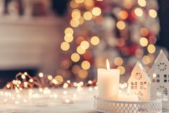 Christmas decoration on a table over blurred lights royalty free stock photography