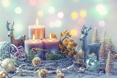 Candles and christmas decoration. On a wooden background royalty free stock image