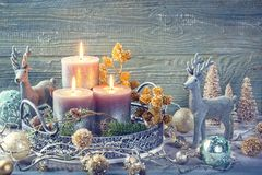 Candles and christmas decoration. On a wooden background royalty free stock photos