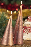 Candles with christmas decorations in atmospheric light Royalty Free Stock Images