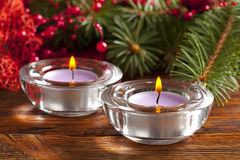Candles and christmas decorations on branch of spruce tree Royalty Free Stock Photography