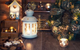 Candles and Christmas decorations on vintage kitchen Royalty Free Stock Images