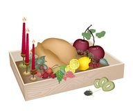 Candles with Christmas Dinner in Wooden Container Royalty Free Stock Photography