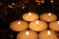 7 candles and Christmas garlands. Festive atmosphere. royalty free stock photography