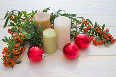 Candles and Christmas. Ornaments on white painted wood Royalty Free Stock Images