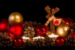 Candles with christmas pine cone in atmospheric light Stock Photos