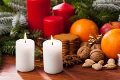 Candles on a christmas table Stock Photos