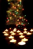 Candles and the christmas tree Stock Images