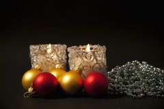 Candles  with christmas-tree decorations Royalty Free Stock Photos