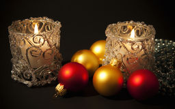Candles  with christmas-tree decorations Stock Photos