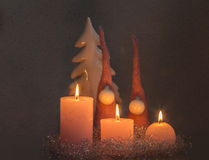 Candles with christmas tree. Christmas tree made of ceramics and felt Royalty Free Stock Photos