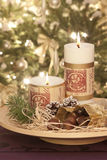 Candles at christmastime. With pine and maroon stock image