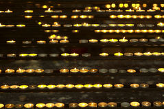 Candles in church. Rows of burning candles in a catholic church Royalty Free Stock Images