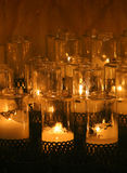 Candles in church. Group of lit candles in church chapel Royalty Free Stock Images