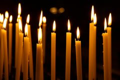 Candles in a church Stock Images