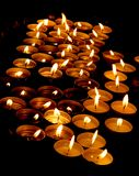 Candles in a church as a symbol of a prayer Stock Images