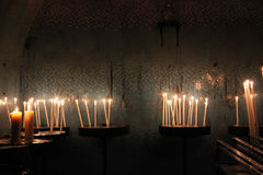 Candles in church on dark background Stock Images
