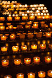 Candles in church. Dark background, quiet atmosphere, calm stock image