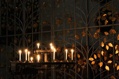 Candles in the church. Candles and golden leaves in the church royalty free stock images