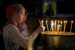 Candles Church Nativity. A woman lights a candle at the Church of the Nativity in Bethlehem Stock Image