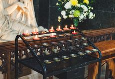 Candles in church, praying flame of God stock images
