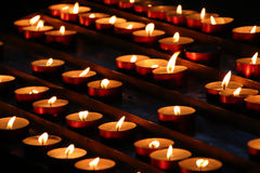 Candles in a church. Raw of burning candles in a church Stock Image