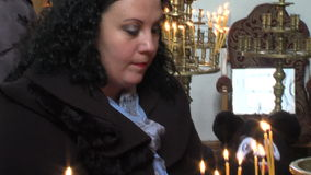 Candles in the church of St. Petka of Bulgaria in Rupite stock footage
