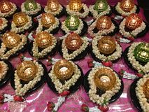 Candles circled with white flowers in a buddhist temple stock photo