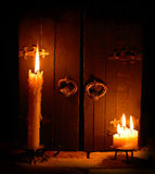 Candles with closed doors Royalty Free Stock Photos