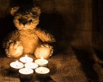 Candles. With a cloth background useful for websites and winter holidays Stock Photography