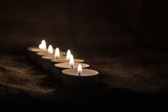 Candles. With a cloth background useful for websites and winter holidays Stock Image