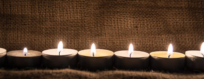 Candles. With a cloth background useful for websites and winter holidays Royalty Free Stock Images