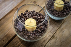 Candles in coffee beans Stock Photography