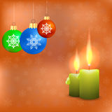 Candles and Colorful Glass Balls. Isolated on Orange Snowflakes Background. Winter Pattern Royalty Free Stock Photo