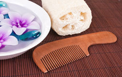 Candles , comb and loofah Royalty Free Stock Photo