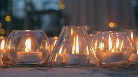 Candles in cones and flasks. White candles in flasks. candles in cones and flasks stock video footage