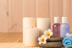 Candles and cosmetics for spa and massage Royalty Free Stock Photography