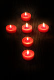 Candles  in a cross Royalty Free Stock Images
