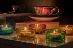 Candles and cup. Candles and tea cup on the book Royalty Free Stock Image