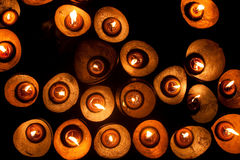 Candles in the dark. Candles put together in a cold dark night Royalty Free Stock Photo
