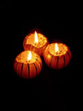 Candles in the dark. 3 lighted golden candles in the dark Royalty Free Stock Images