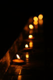 Candles in the dark. Candles put together in a cold dark night Royalty Free Stock Photography