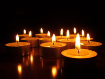 Candles In The Dark. Lit tea lights in the dark Royalty Free Stock Photography