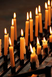 Candles in the dark. Church, belief and religion concept Stock Images